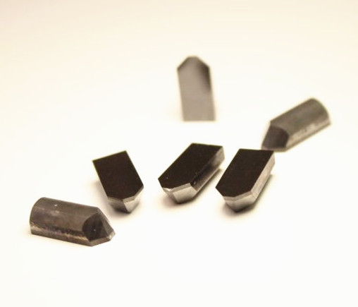 PCD notching tools for carbide roller